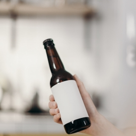 person-holding-white-labeled-bottle-4068312